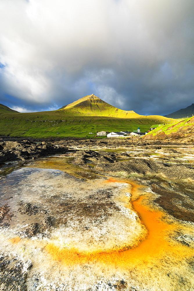 Rock formation in water, Gjogv, Eysturoy island, Faroe Islands, Denmark, Europe