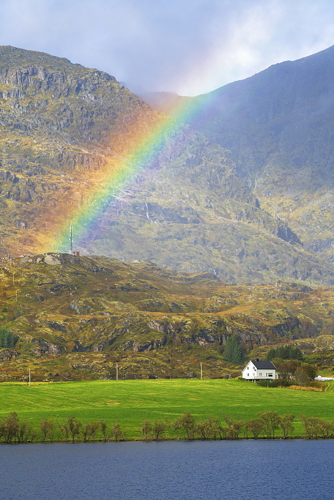 Rainbow over mountain in Leknes, Lofoten Islands, Norway, Europe