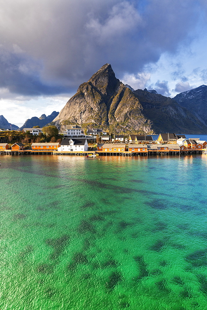 Fishing village of Sakrisoy with Olstinden mountain on background, Reine, Nordland, Lofoten Islands, Norway