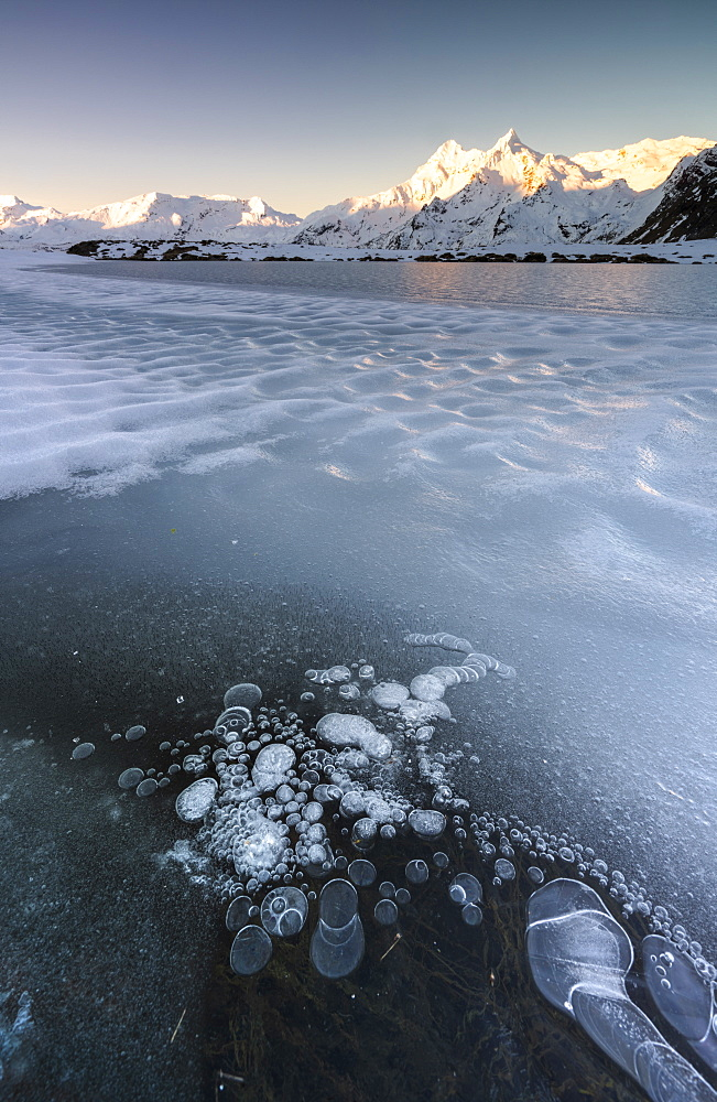 Ice bubbles on frozen Lago Andossi with Pizzi Dei Piani on background, Spluga Valley, Sondrio, Valtellina, Lombardy, Italy - 1179-3819