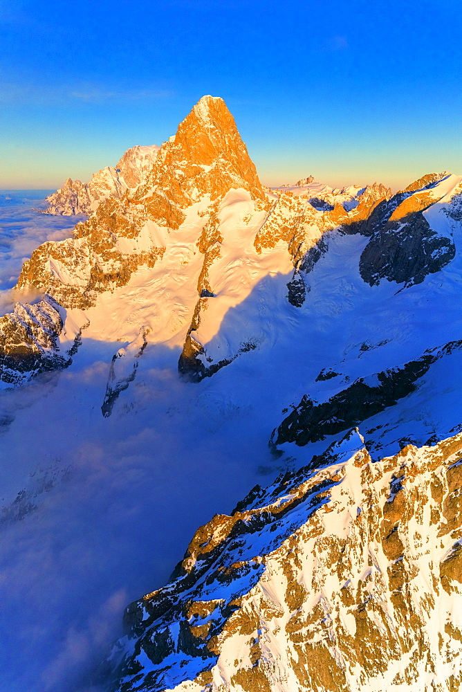 Aerial view of Grandes Jorasses and Mont Blanc covered with snow, Courmayeur, Aosta Valley, Italy