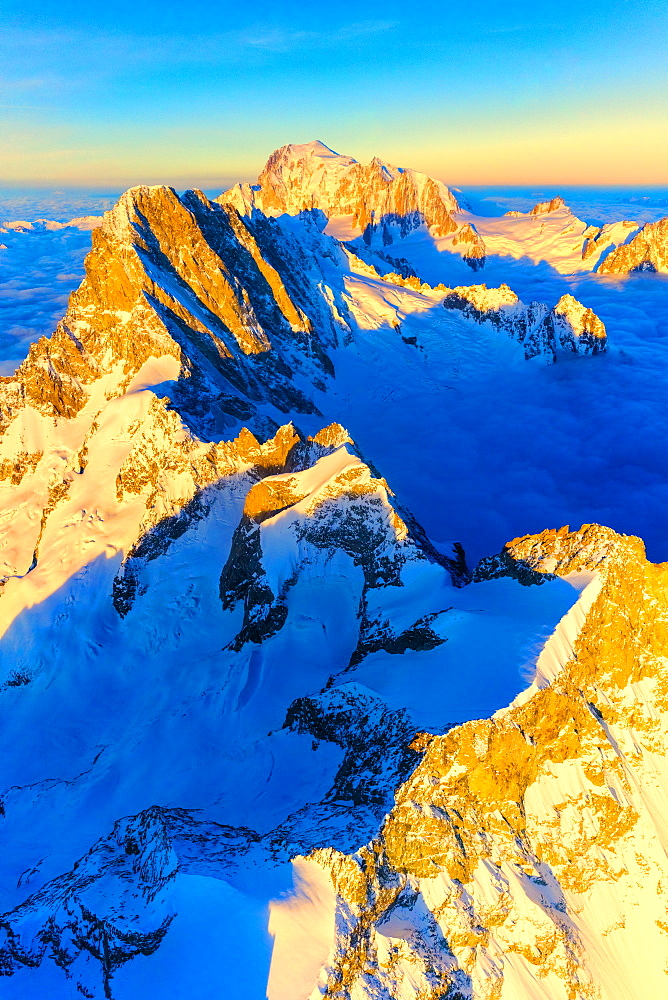 Aerial view of Grandes Jorasses, Petites Jorasses, Aiguille De Leschaux and Mont Blanc at dawn, Courmayeur, Aosta Valley, Italy
