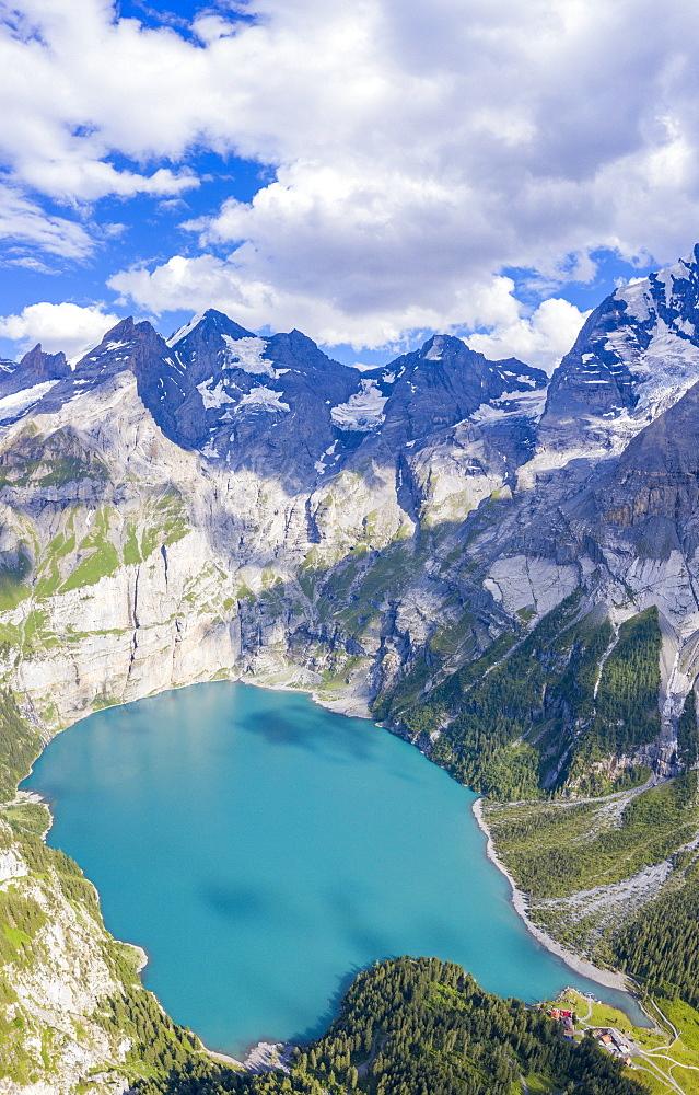 Aerial panoramic of alpine Oeschinensee lake, Bernese Oberland, Kandersteg, Canton of Bern Switzerland, Europe