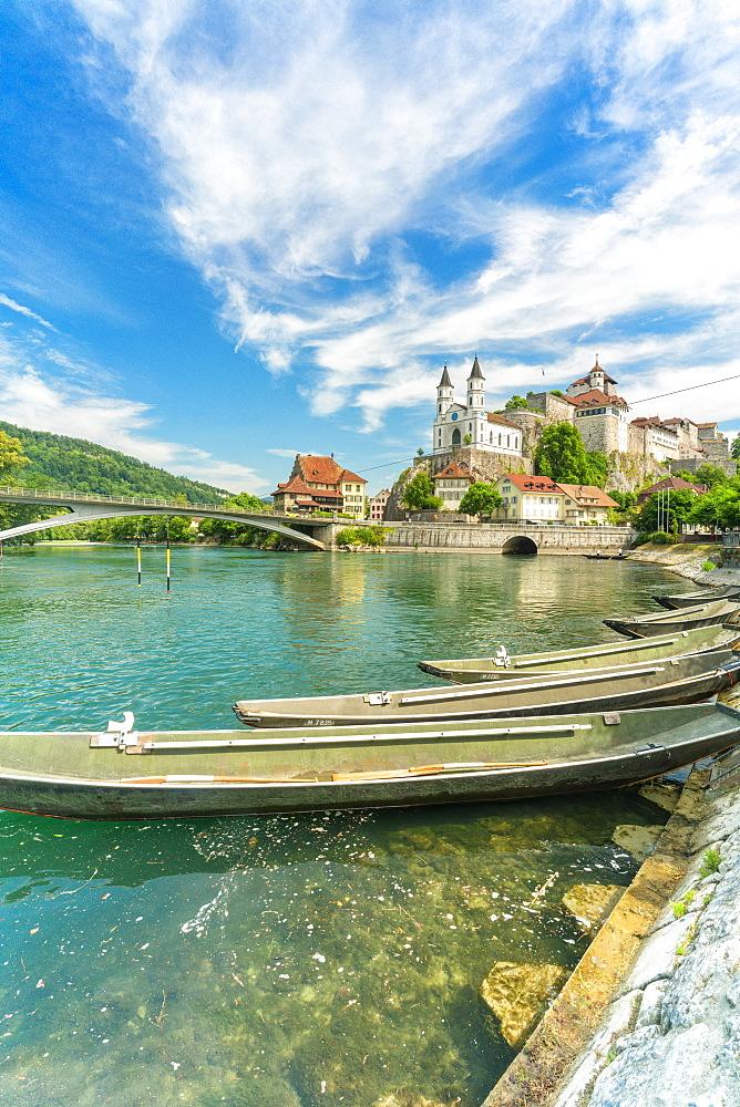 Boats moored in Aare River with Aarburg Castle in background, Aarburg, Canton of Aargau, Switzerland, Europe