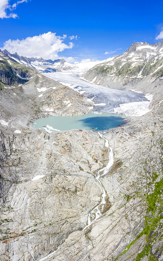 Aerial panoramic of Rhone Glacier and glacial lake at its base, Gletsch, Canton of Valais, Switzerland, Europe