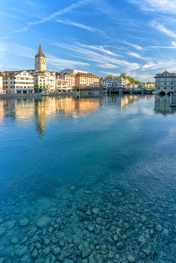 Clock tower of St. Peter church mirrored in the turquoise water of Limmat River, Lindenhof, Zurich, Switzerland, Europe - 1179-4028