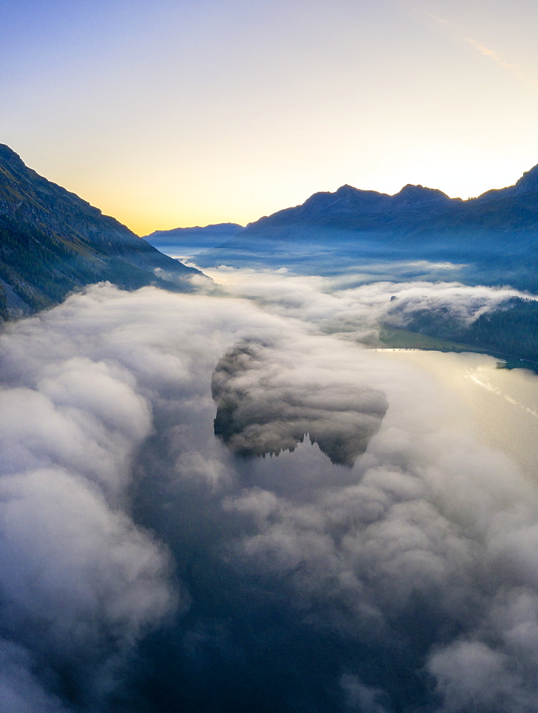 Lake Silvaplana and Sils hidden by the autumnal fog at dawn, aerial view by drone, Engadine, Canton of Graubunden, Switzerland, Europe - 1179-4071