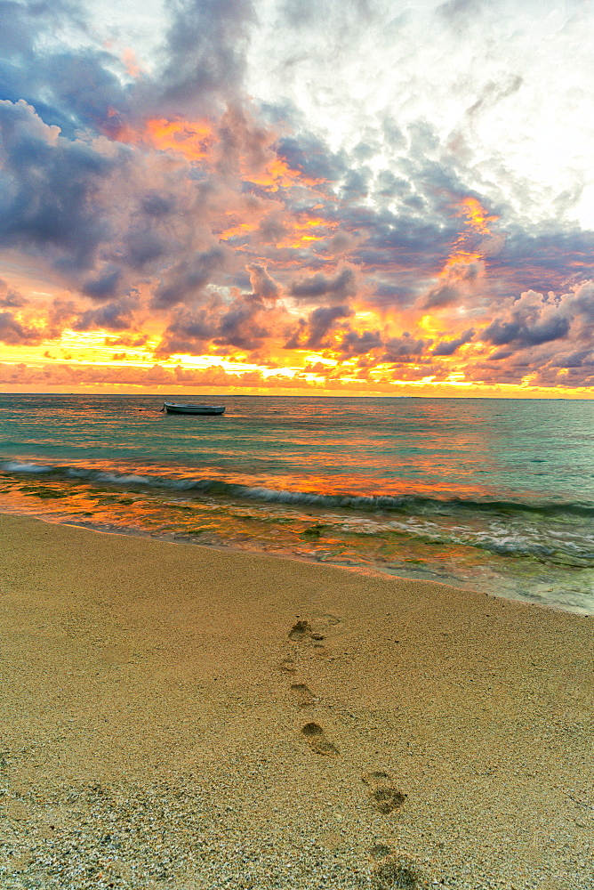 African sunset over footprints on tropical sand beach, Le Morne Brabant, Black River, Mauritius, Indian Ocean, Africa - 1179-4150