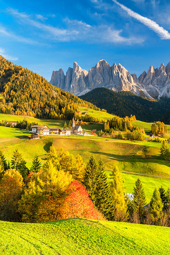 Sunset over the Odle Group and village of Santa Magdalena in autumn, Funes Valley, Dolomites, Bolzano, South Tyrol, Italy