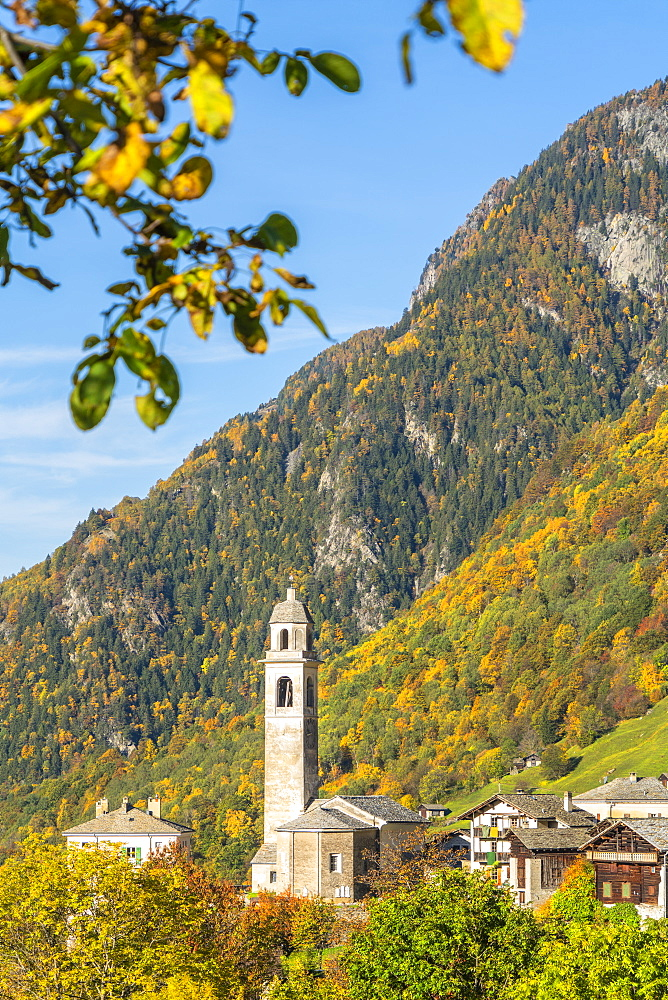 Old bell tower and church in the autumnal landscape, Soglio, Val Bregaglia, Canton of Graubunden, Switzerland, Europe