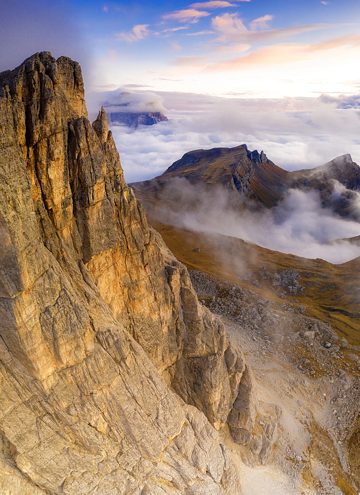 Aerial view by drone of autumn sunset over Lastoi De Formin, Mondeval and Monte Pelmo, Giau Pass, Dolomites, Belluno, Veneto, Italy, Europe