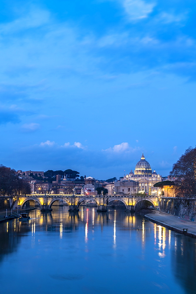 River Tiber with bridge Umberto I and St. Peter's Basilica (Basilica di San Pietro) in background at dusk, Rome, Lazio, Italy