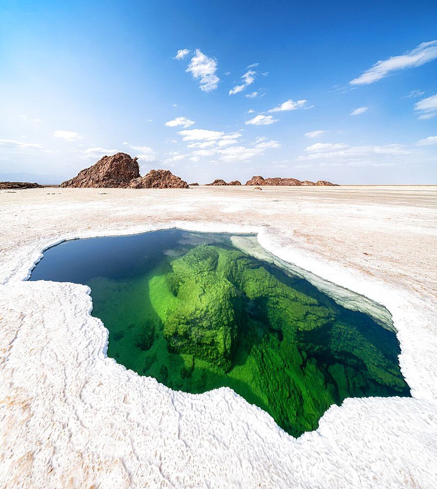 Panoramic of the transparent water of natural pond in the salt pan, Danakil Depression, Afar Region, Ethiopia, Africa