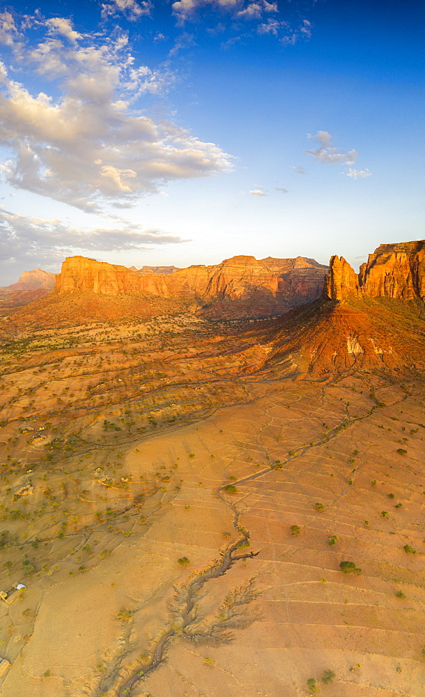 Aerial panoramic by drone of Gheralta Mountains lit by sunset, Hawzen, Tigray Region, Ethiopia, Africa