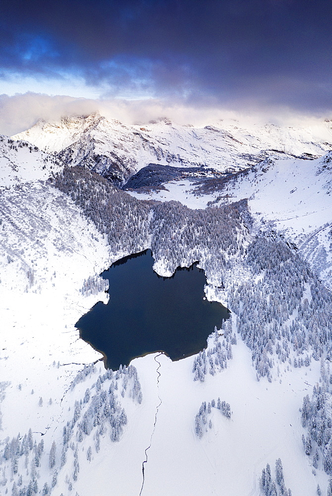 Lake Cavloc surrounded by snow, aerial view, Bregaglia Valley, Engadine, canton of Graubunden, Switzerland, Europe