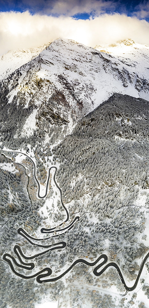Bends of Maloja Pass road on snowy mountain ridge, aerial view, Bregaglia Valley, Engadine, canton of Graubunden, Switzerland, Europe