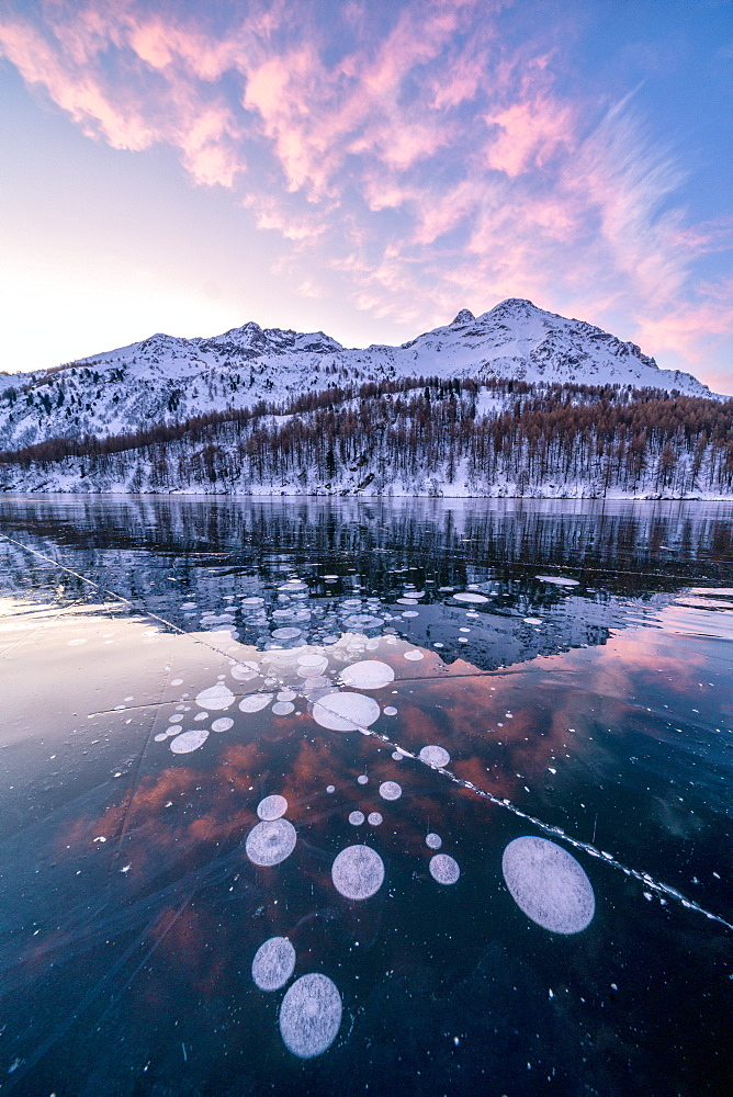 Frozen Lake Sils at sunrise with Piz Da La Margna in background, Engadine, canton of Graubunden, Switzerland, Europe