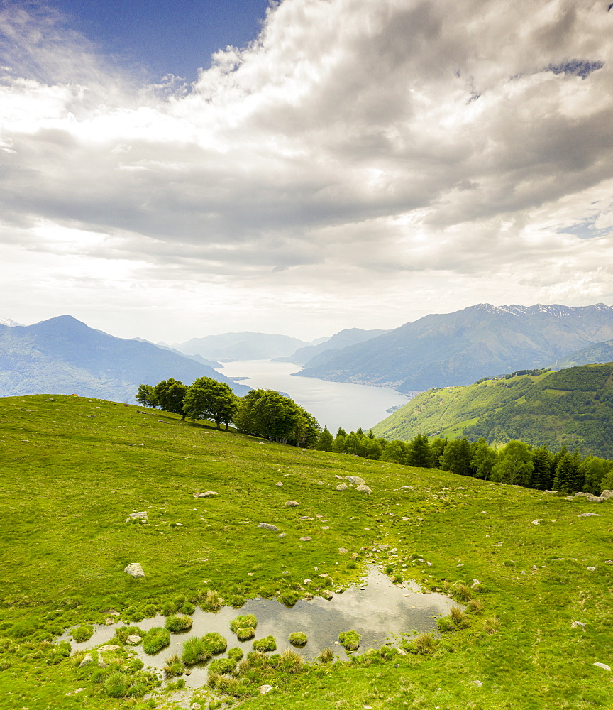 Alto Lario and Lake Como seen from green meadows of Montemezzo mountains, Lombardy, Italy
