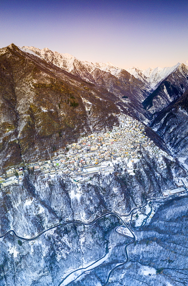 Aerial panoramic of Premana village during winter dusk, Valsassina, Lecco province, Lombardy, Italy (drone)