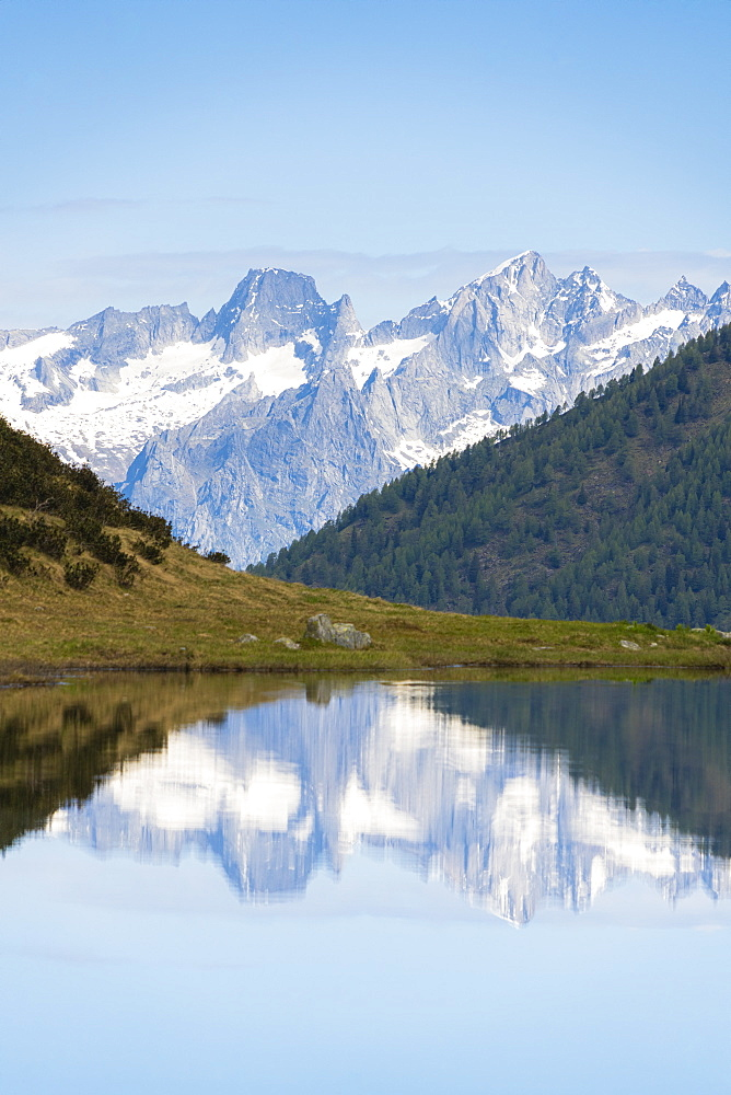 Piz Badile and Cengalo reflected in Porcile Lakes, Val Lunga, Tartano Valley, Valtellina, Sondrio province, Lombardy, Italy, Europe