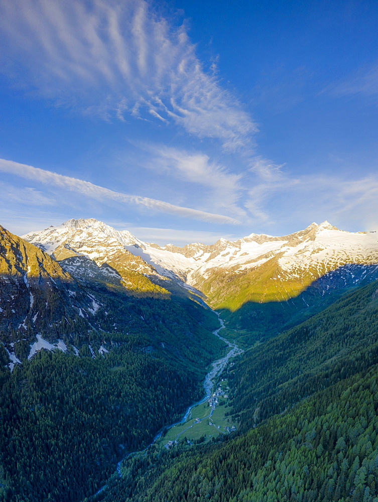 Aerial panoramic of Monte Disgrazia and Chiareggio valley at dawn, Valmalenco, Sondrio province, Valtellina, Lombardy, Italy, Europe