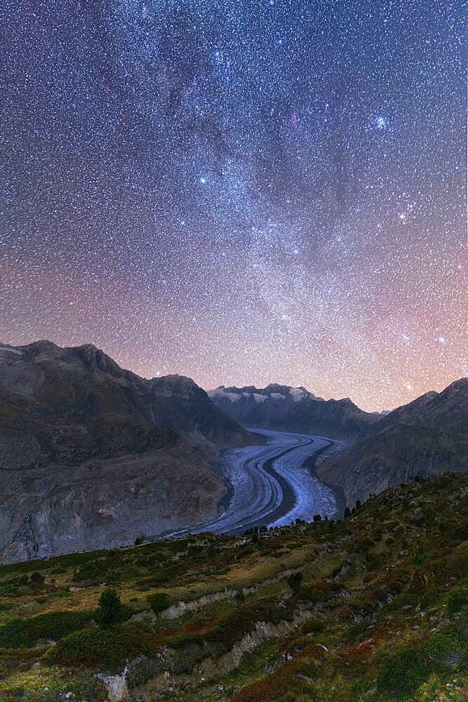 Glowing stars and Milky Way in the night sky over Aletsch Glacier, Bernese Alps, Valais canton, Switzerland - 1179-4864