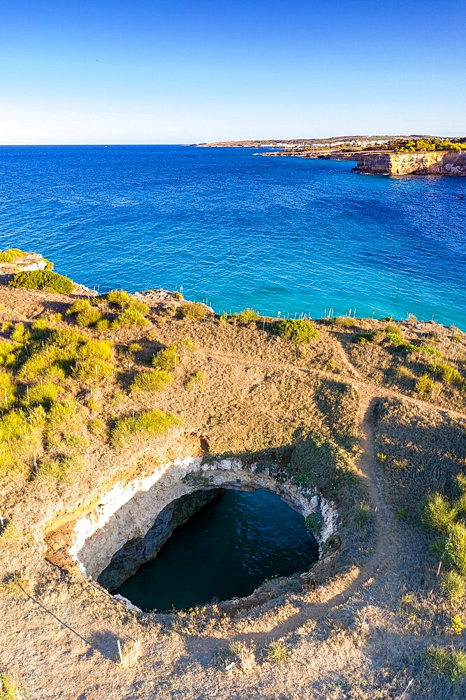 Natural stone arch and open grotto framed by turquoise sea, Otranto, Lecce province, Salento, Apulia, Italy, Europe - 1179-4979