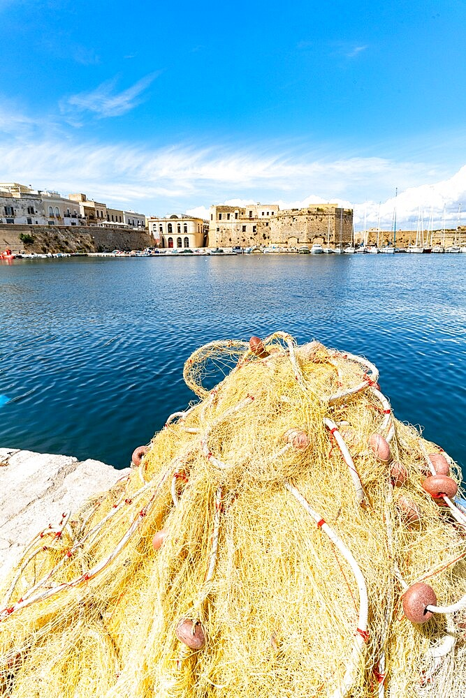 Fishing nets in the harbor surrounded by old town and castle by the sea, Gallipoli, Lecce province, Salento, Apulia, Italy, Europe - 1179-4988
