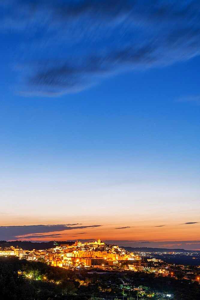 Illuminated old town of Ostuni at dusk, province of Brindisi, Salento, Apulia, Italy, Europe - 1179-4995