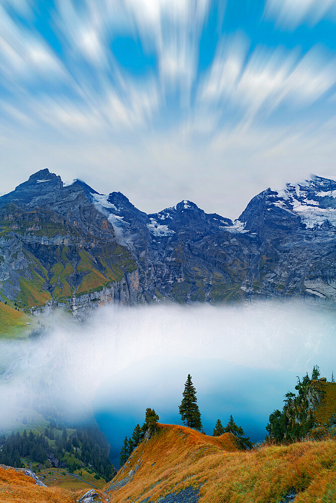 Clouds in the sky above lake Oeschinensee covered by fog, Bernese Oberland, Kandersteg, canton of Bern, Switzerland - 1179-5042