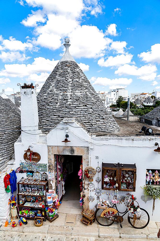 Handcraft souvenirs in the Trullo traditional stone hut, Alberobello, province of Bari, Apulia, Italy - 1179-5060