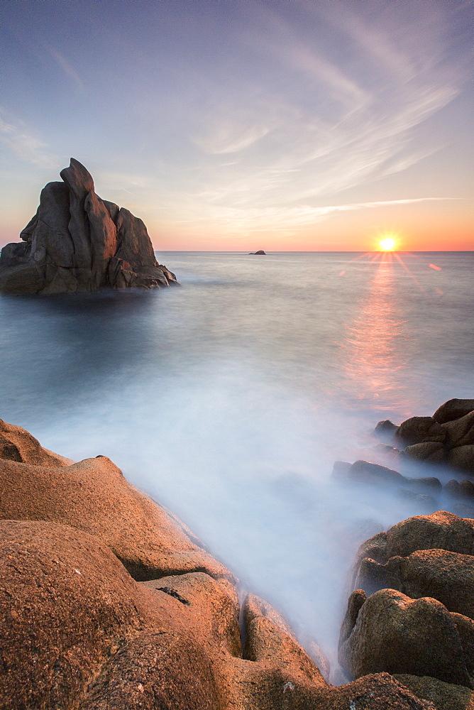 The sun setting behind the rocks of the peninsula of Capo Testa, by Santa Teresa di Gallura, Sardinia, Italy, Mediterranean, Europe