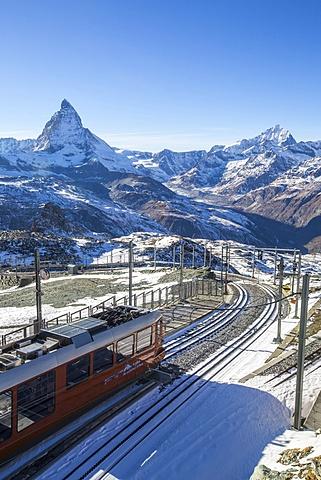 A train from Zermatt approaching the Gornergrat Station facing the majestic shape of the Matterhorn, Switzerland