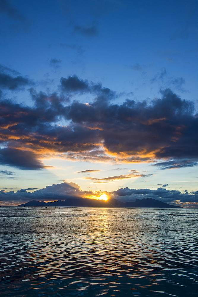 Dramatic sunset over Moorea, Papeete, Tahiti, Society Islands, French Polynesia, Pacific