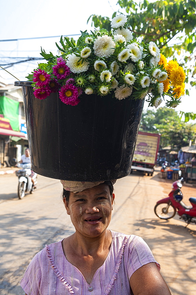 Woman selling flowers, Ye, Mon state, Myanmar (Burma), Asia