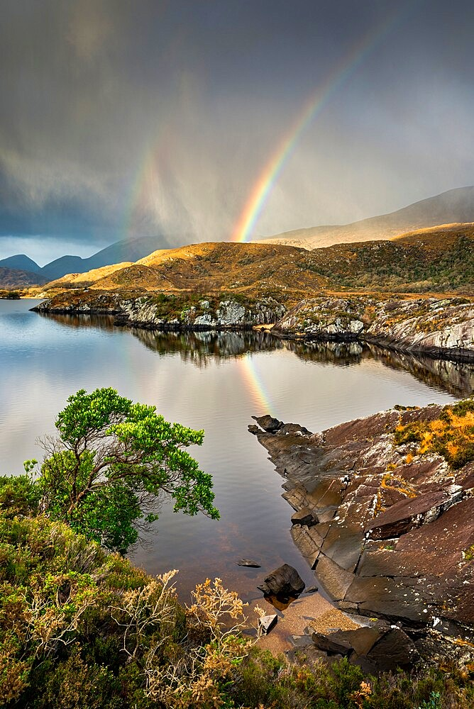 Rainbow and rain clouds over Upper Lake, Killarney National Park, Ireland. - 1200-381