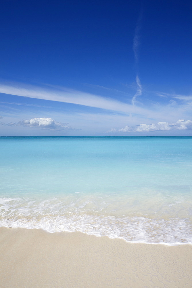 The sands of Grace Bay, the most spectacular beach on Providenciales, Turks and Caicos, in the Caribbean.