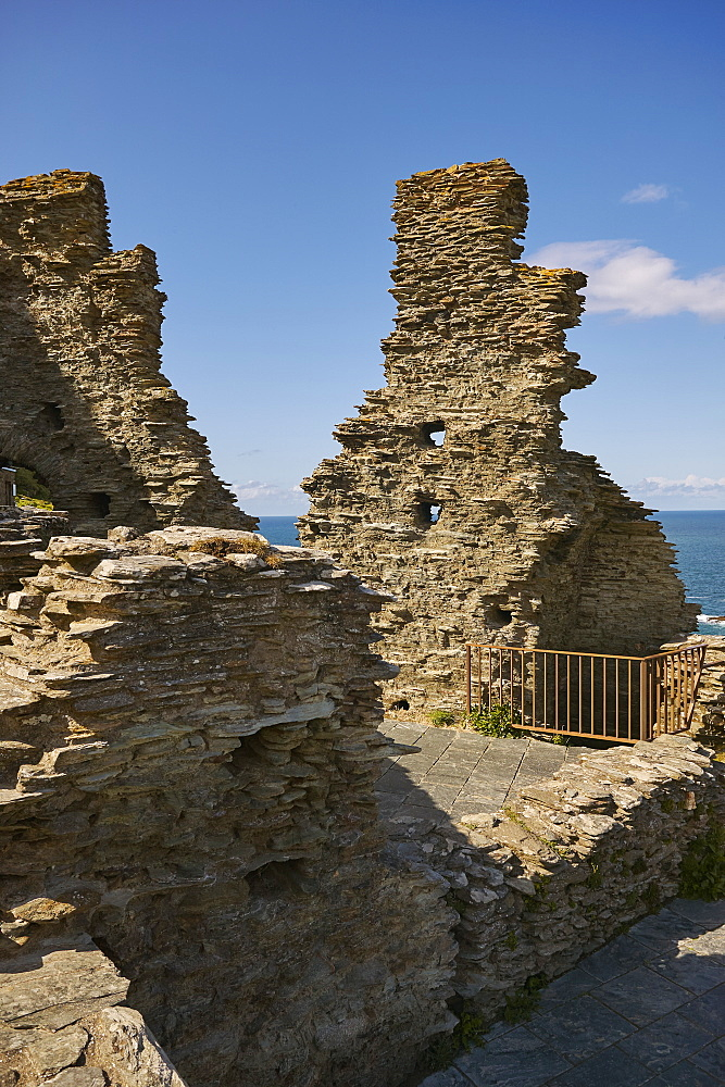 The Medieval ruins of Tintagel Castle, allegedely the birthplace of King Arthur, on Atlantic coast cliffs at Tintagel, Cornwall.