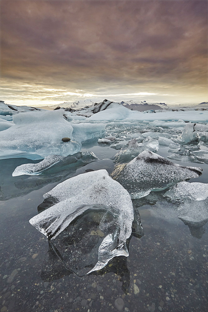 An iconic Icelandic landscape, an ice-filled lagoon fed by the Vatnajokull icecap, at Jokulsarlon, on the south coast of Iceland, Polar Regions - 1202-422