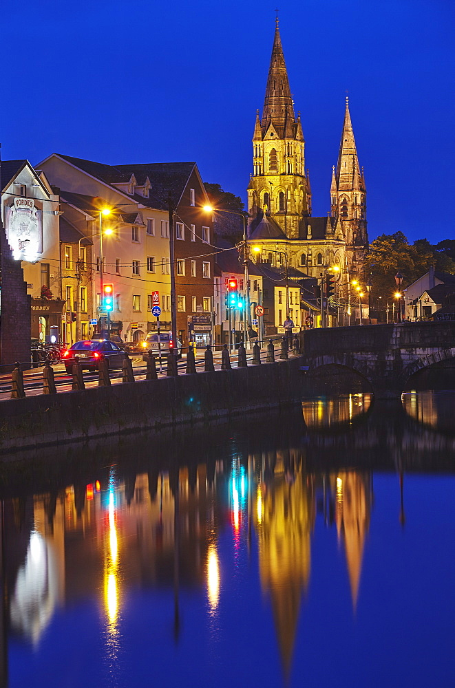 A dusk view of St Fin Barre's Cathedral, on the banks of the Lee River, in Cork, Ireland.