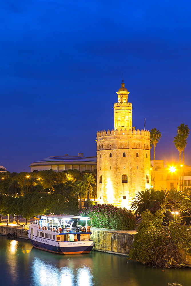 Torre del Oro (Gold Tower) and river Rio Guadalquivir at night, Seville, Andalusia, Spain, Europe