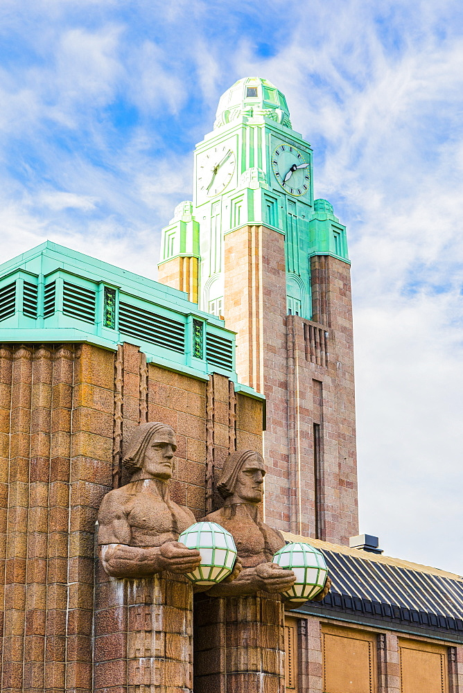 Emil Wikstrom's statues on Helsinki Central Station in Helsinki, Finland, Europe