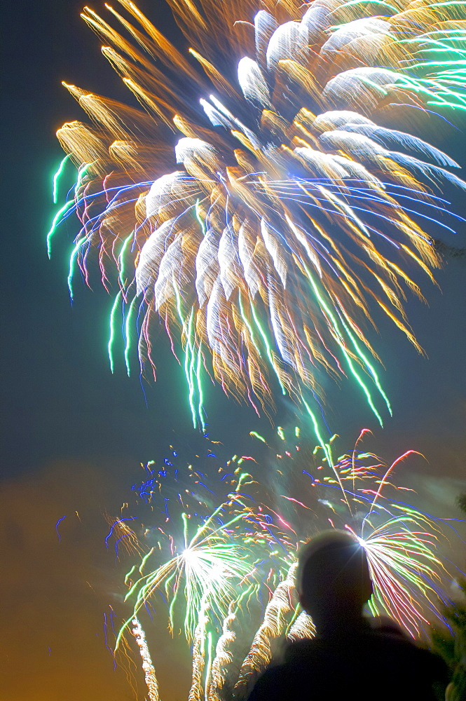 A man watching fireworks, United Kingdom, Europe