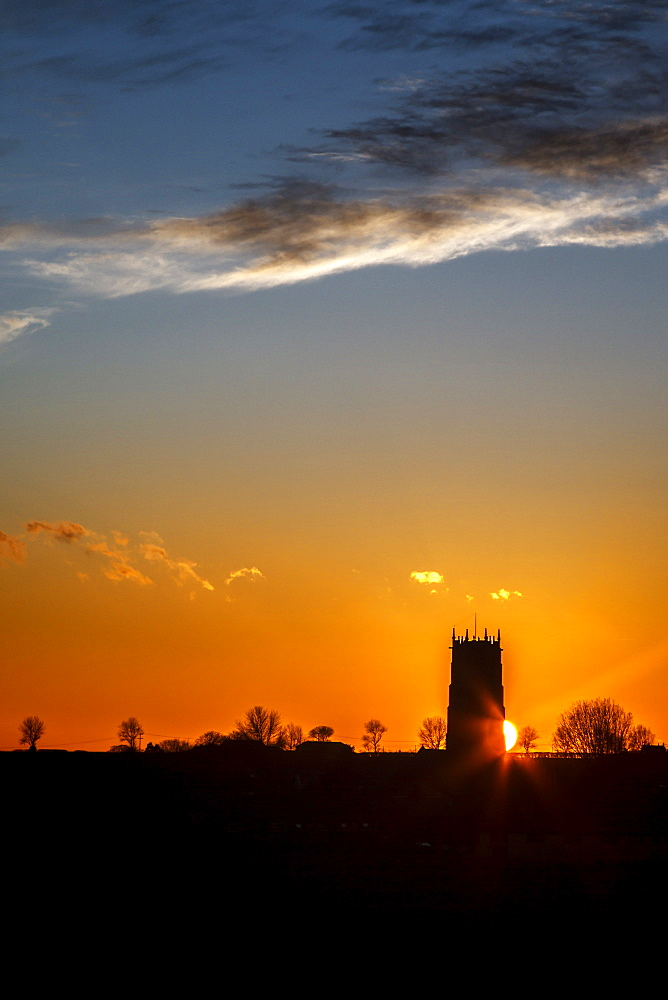 Sunset behind the Parish Church of the Holy Trinity and All Saints at Winterton on Sea, Norfolk, England, United Kingdom, Europe - 1213-46