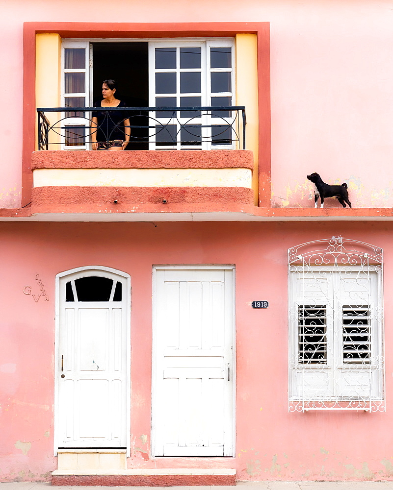 Woman looking for the dog, Cienfuegos, Cuba, West Indies, Caribbean, Central America