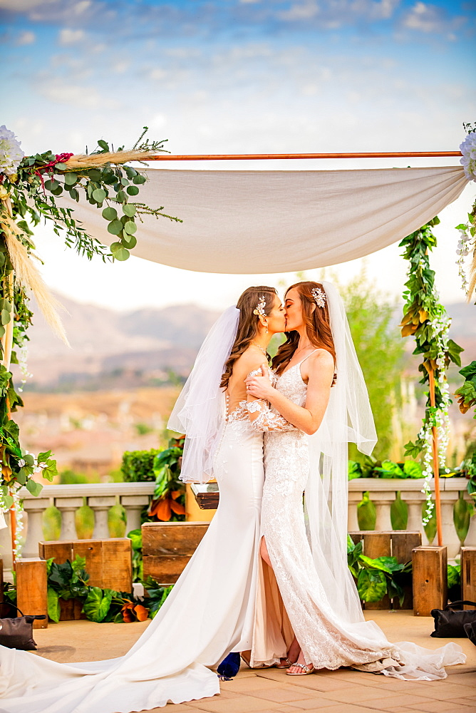 Brides sharing the pronounced kiss, Corona, California, United States of America, North America