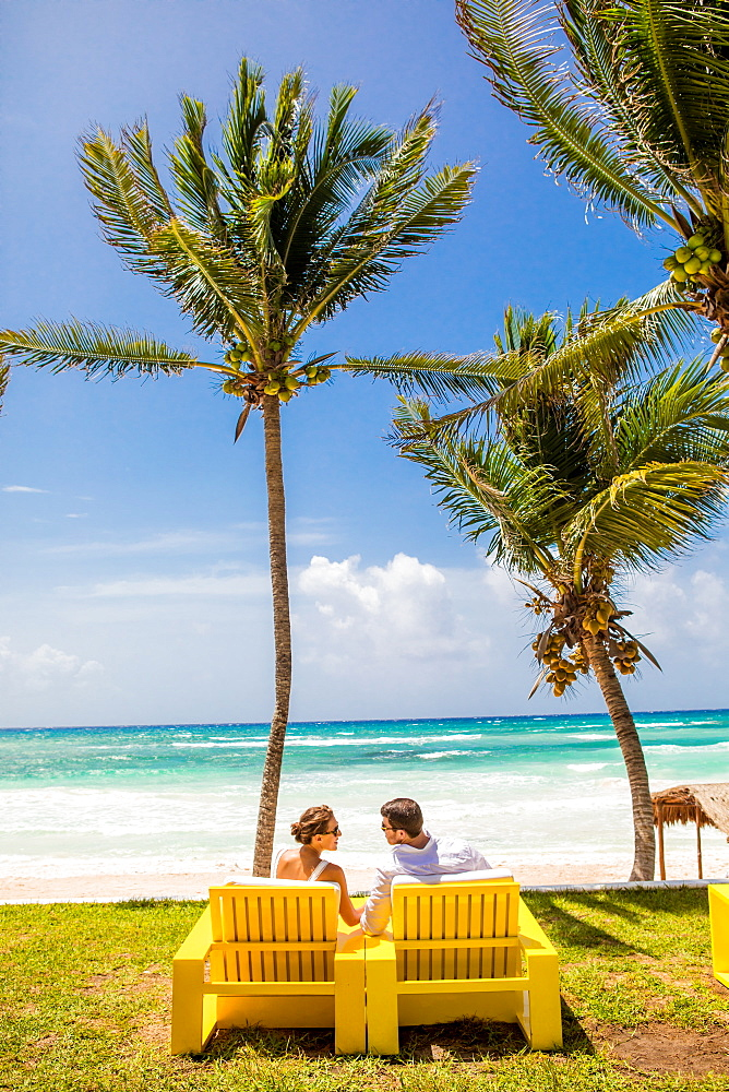 Couple beachside in Tulum, Yucatan, Quintana Roo, Mexico, North America