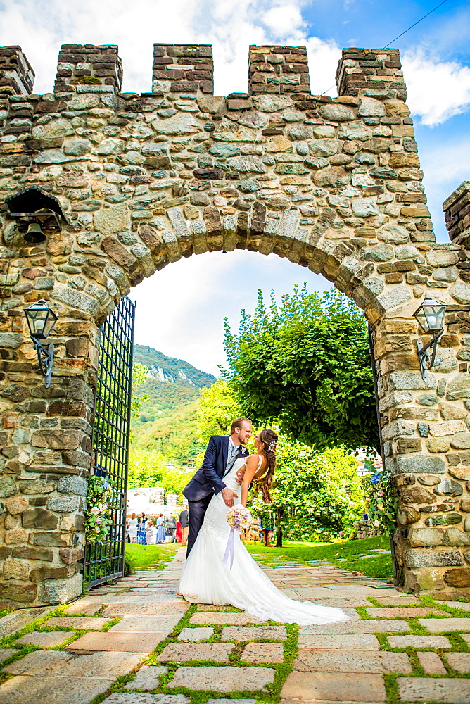 Couple, bride and groom, posing at the Castello di Rossino, Lake Como, Lombardy, Italy, Europe - 1218-760