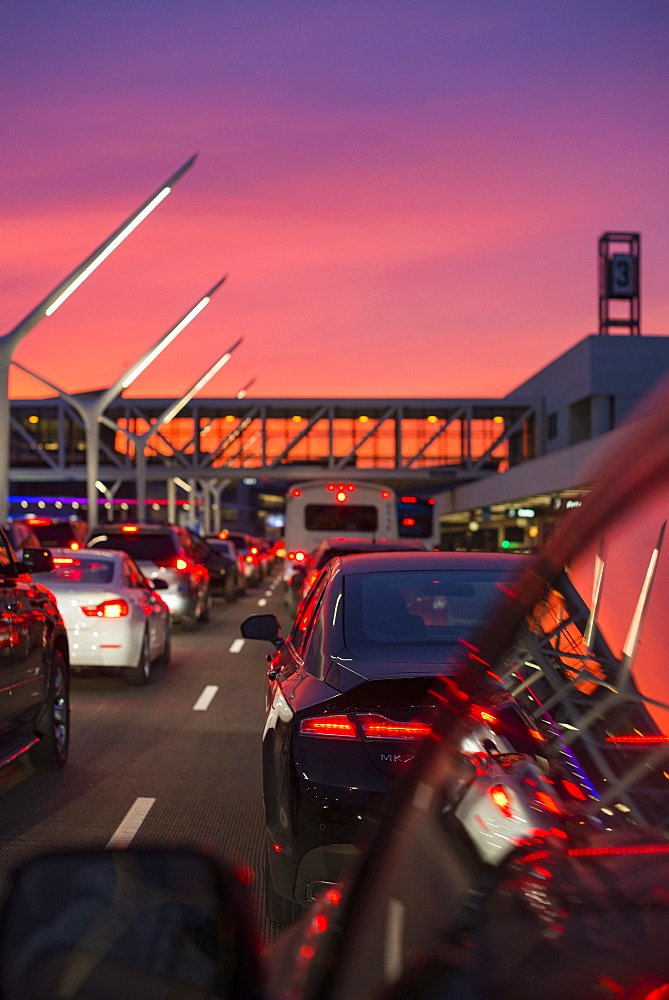 Traffic going into Los Angeles airport under a vibrant orange and pink sunset, California, United States of America, North America - 1225-1215