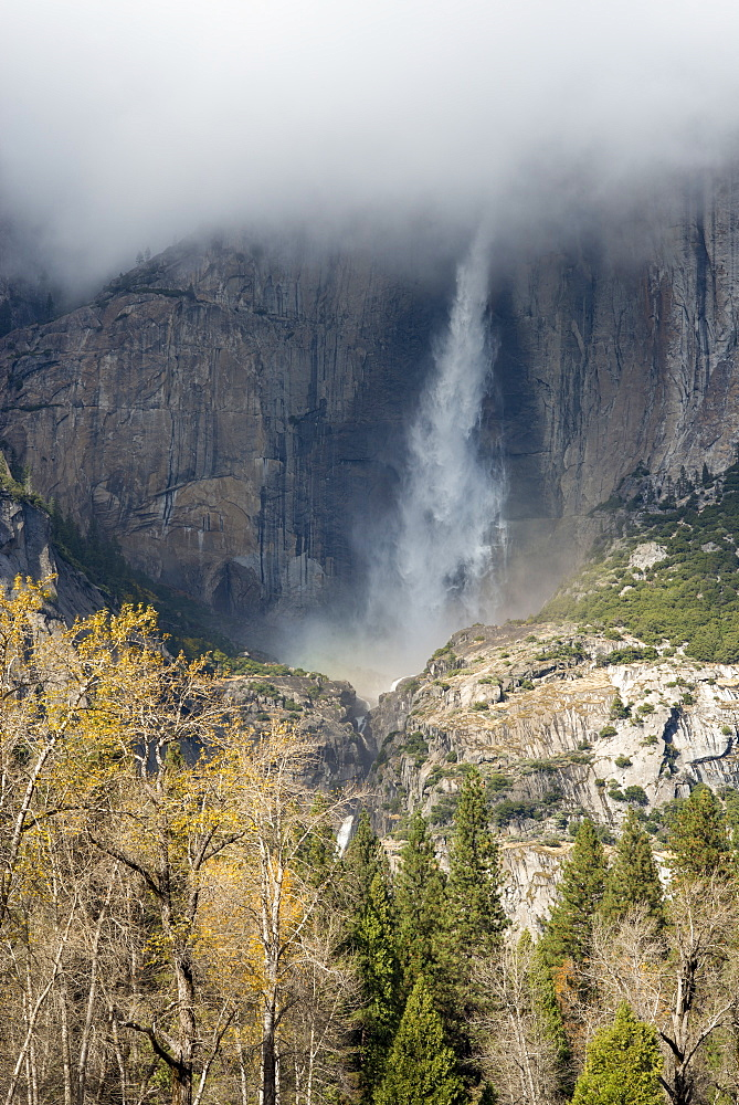 Waterfall emerging from clouds from El Capitan in Yosemite National Park, UNESCO World Heritage Site, California, United States of America, North America